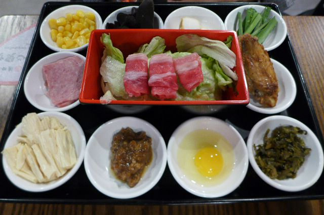A constellation of ingredients in small bowls on a tray.