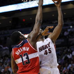 Miami Heat's Dexter Pittman (45) goes to the basket as Washington Wizards' Kevin Seraphin (13) defends in the first half of an NBA basketball game in Miami, Saturday, April 21, 2012.