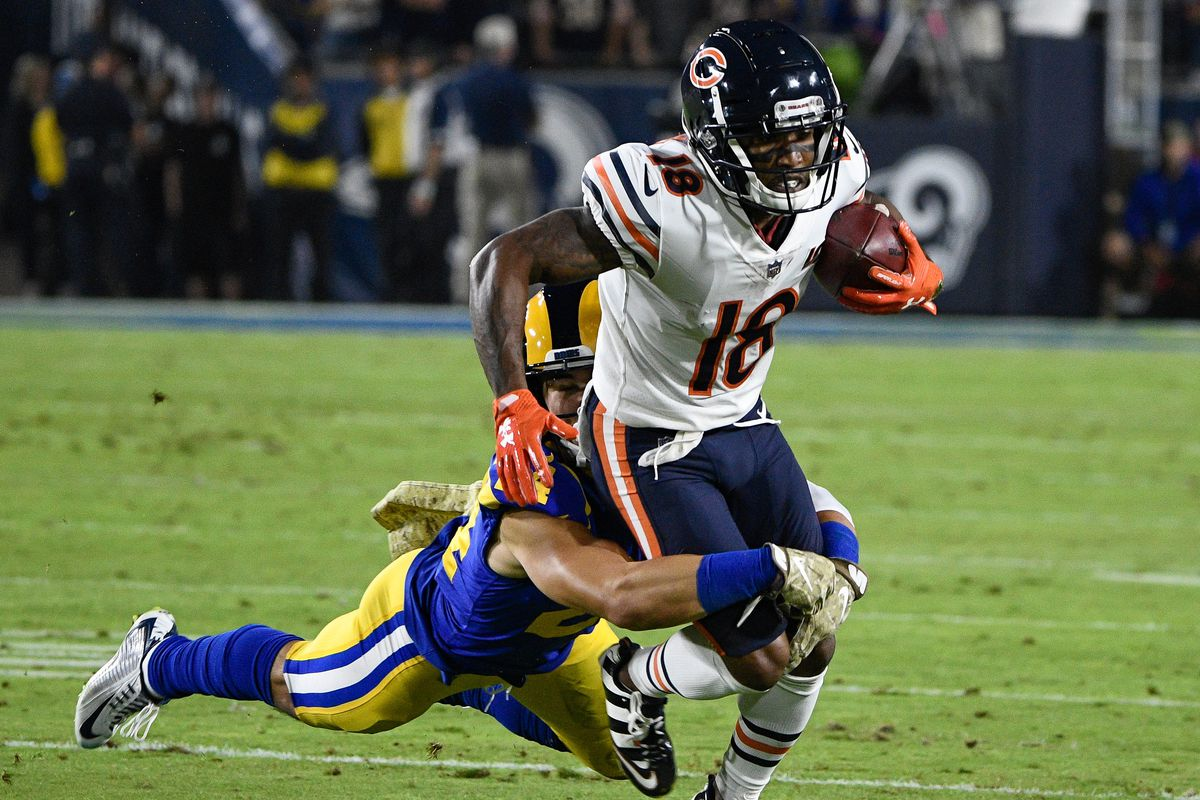 Los Angeles Rams safety Taylor Rapp makes a diving tackle on Chicago Bears wide receiver Taylor Gabriel during the first quarter at Los Angeles Memorial Coliseum.