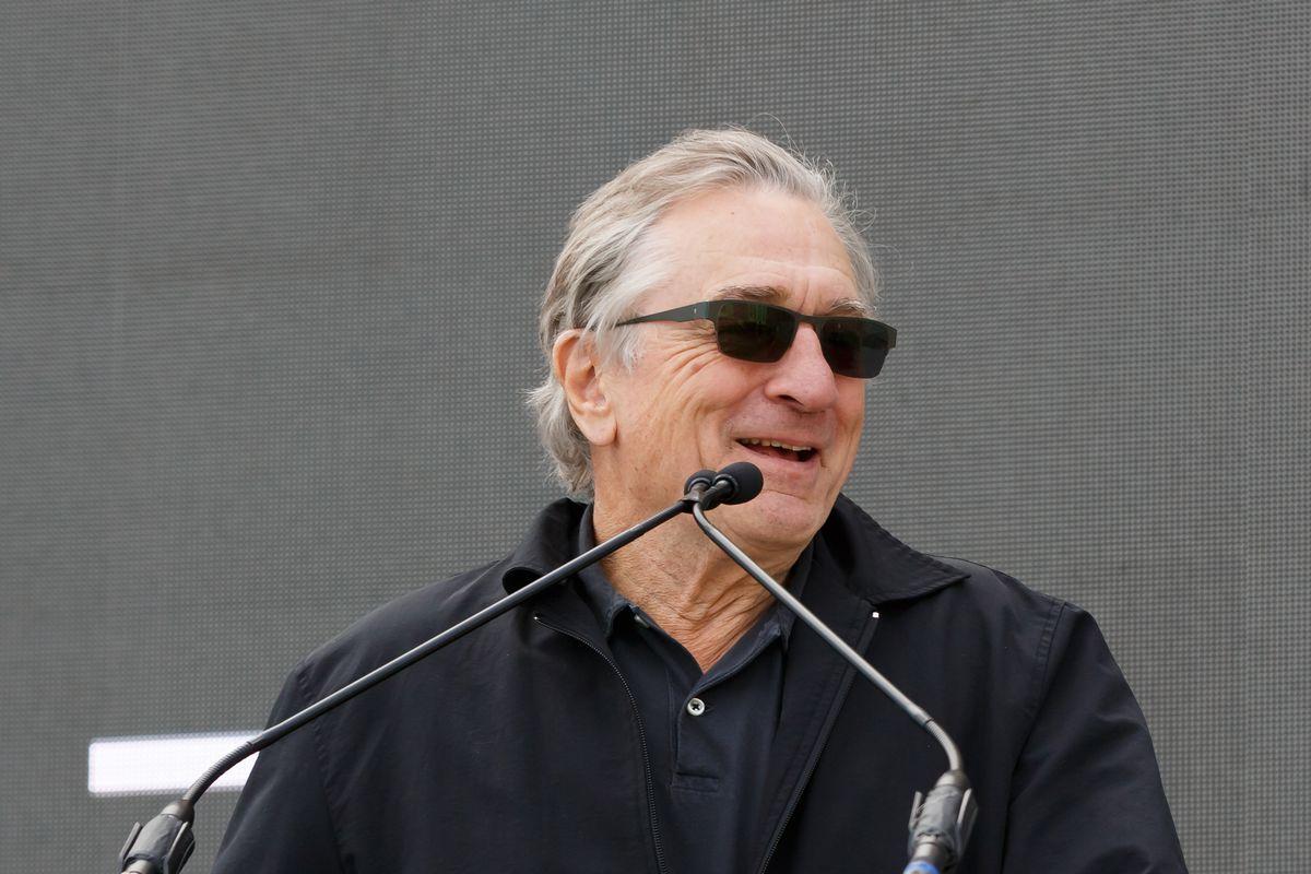 Robert De Niro standing at podium.