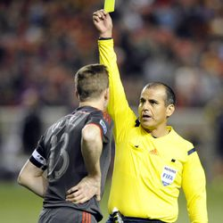 Toronto FC defender Doneil Henry (15) receives a yellow card during a game against the Real Salt Lake at Rio Tinto Stadium in Sandy on Saturday, March 29, 2014.