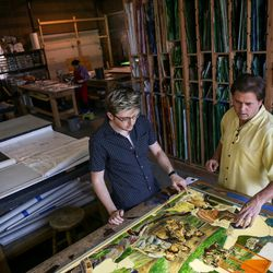 """Tom Holdman, right, and his son, Thomas Holdman Jr., assemble an art glass panel that will be part of """"The Roots of Knowledge,"""" a 200-foot-long stained glass installation for Utah Valley University, at Holdman Studios in Lehi on Friday, Nov. 4, 2016. A Guardian UK reporter called the work """"one of the most spectacular stained glass windows made in the past century."""""""