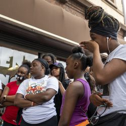 Zaniya Cribbs, far right, a niece of Verndell Smith, wipes away tears during a press conference at Ultimate Threat Dance Organizations studio, Thursday, May 20, 2021. Verndell, the founder of the dance studio was shot and killed yesterday.