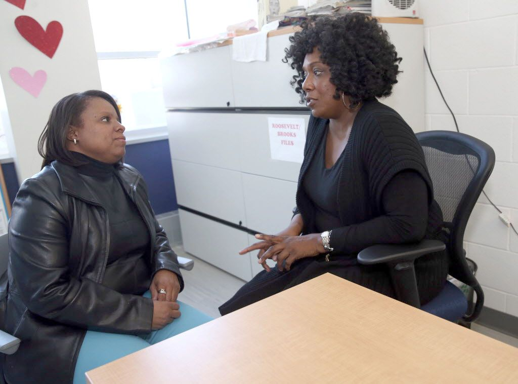 Charisma Pryor (left) met Lisa Butler, both licensed social workers, at a support group meeting.   Kevin Tanaka/For the Sun Times