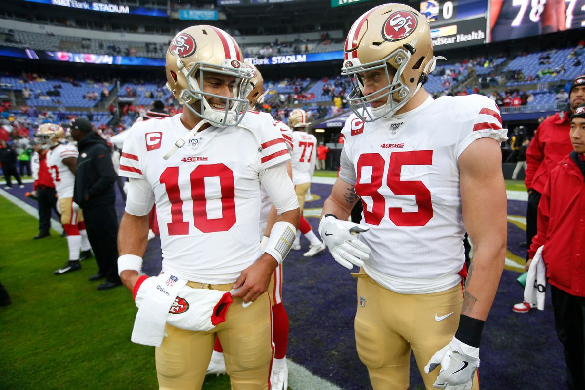Jimmy Garoppolo and George Kittle of the San Francisco 49ers talk on the field prior to the game against the Baltimore Ravens at M&T Bank Stadium on December 1, 2019 in Baltimore, Maryland.