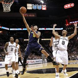 SAN ANTONIO, TX - APRIL 29:  Devin Harris #5 of the Utah Jazz takes a shot against Tony Parker #9 of the San Antonio Spurs in Game One of the Western Conference Quarterfinals in the 2012 NBA Playoffs at AT&T Center on April 29, 2012 in San Antonio, Texas.