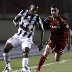 U.S. Real Salt Lake Jonny Steele, right, chases Panama's Tauro FC Jean Alberto McLean, left, during a CONCACAF Champions League soccer match in Panama City, Tuesday, Sept. 18, 2012. U.S. Real Salt Lake won 1-0. (AP Photo/Arnulfo Franco)