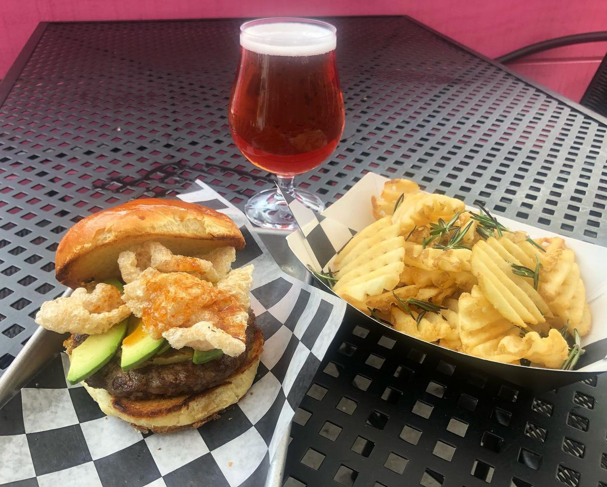 A burger with pork rinds and avocado from Slash Run