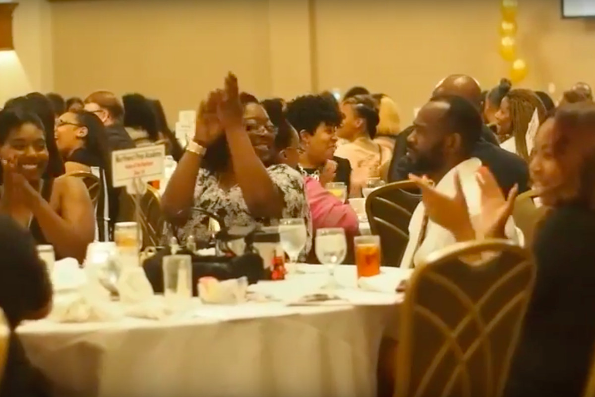 Educators and parents cheer as Shelby County Schools presents checks to each high school's top two students at the district's annual senior gala in April.