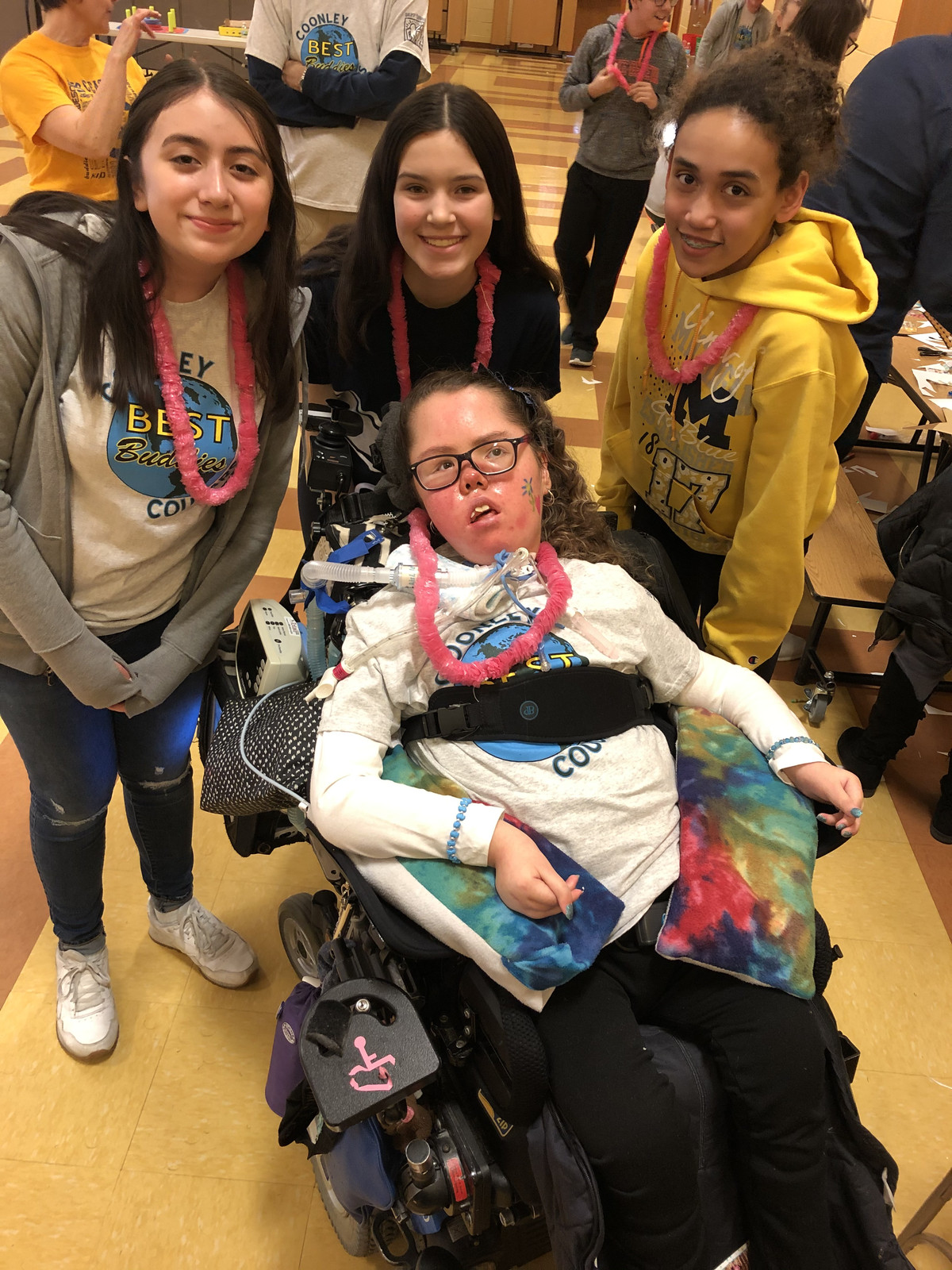 Ally Krajewski with her friends at a game night before schools were closed. Her mom says she misses her friends and her routine.