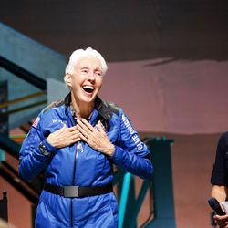 """Wally Funk reacts to applause at a post-launch after getting her ceremonial """"astronaut wings,"""" a tiny pin that serves as a rite of passage for people who've flown beyond 50 miles high, which is the border NASA considers space."""