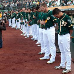 A's observe a moment of silence before their game against the Rangers at O.co Coliseum