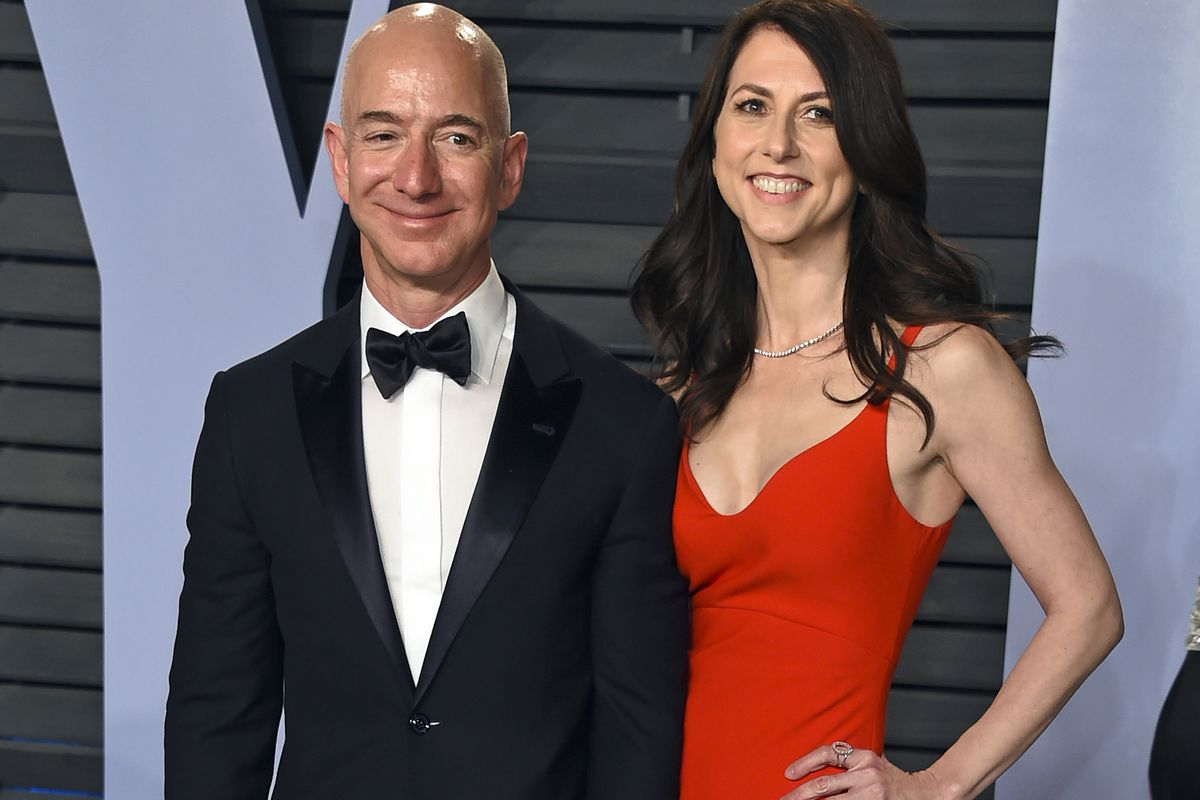 FILE - In this March 4, 2018 file photo, Jeff Bezos and wife MacKenzie Bezos arrive at the Vanity Fair Oscar Party in Beverly Hills, Calif. Jeff Bezos and MacKenzie, announced Thursday, April 4, 2019, in a series of tweets that they have finalized their d
