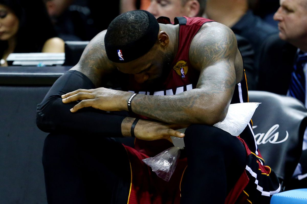 Lebron sits on the bench after cramping up with a few minutes left.