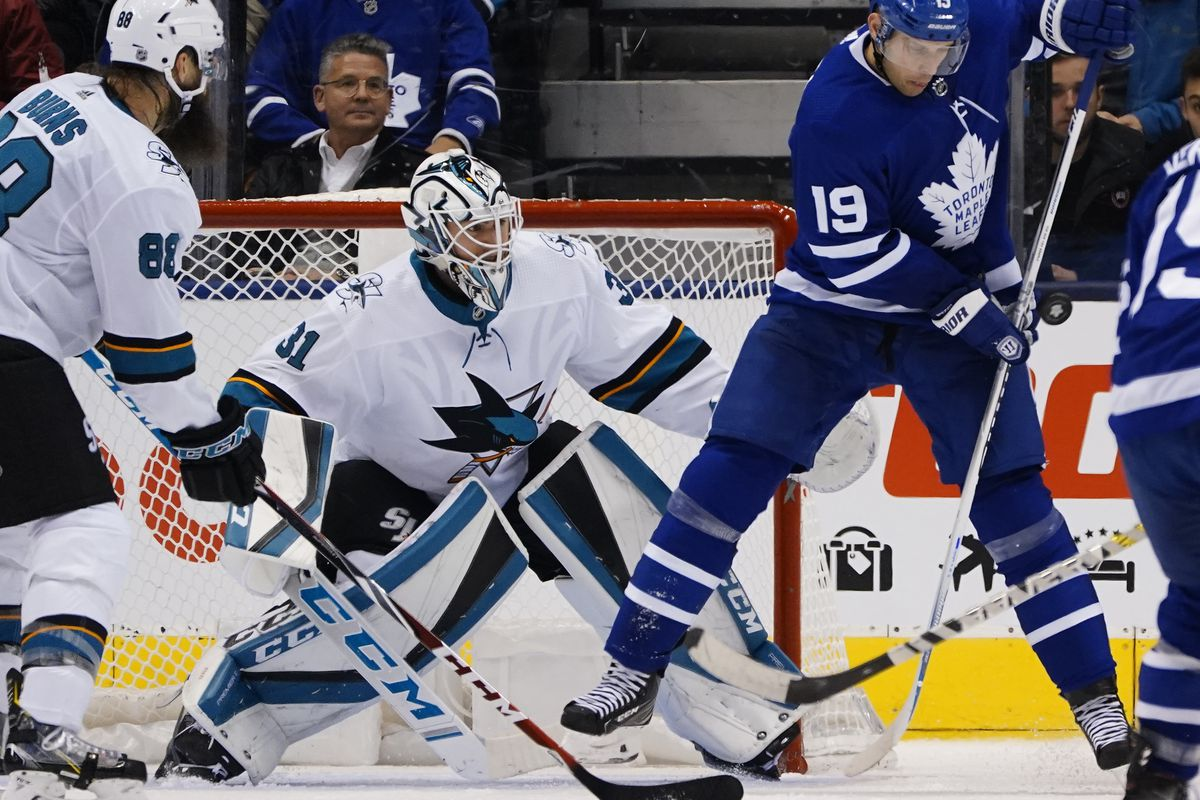 Oct 25, 2019; Toronto, Ontario, CAN; Toronto Maple Leafs forward Jason Spezza (19) tries to tip the puck against San Jose Sharks goaltender Martin Jones (31) during the second period at Scotiabank Arena.