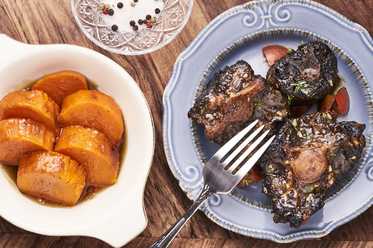 A plate of oxtails and sliced sweet potatoes from Lex Grant