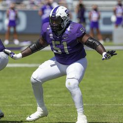 TCU offensive tackle Quazzel White (51) protects quarterback Max Duggan during an NCAA football game against Iowa State on Saturday, Sept. 26, 2020 in Fort Worth, Texas. White is one of a handful of players who has transferred into the Utah State program.