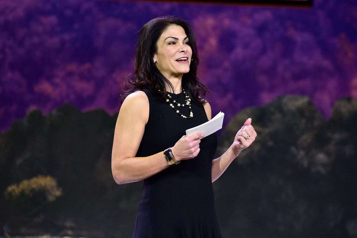 Airbnb COO Belinda Johnson onstage holding notecards