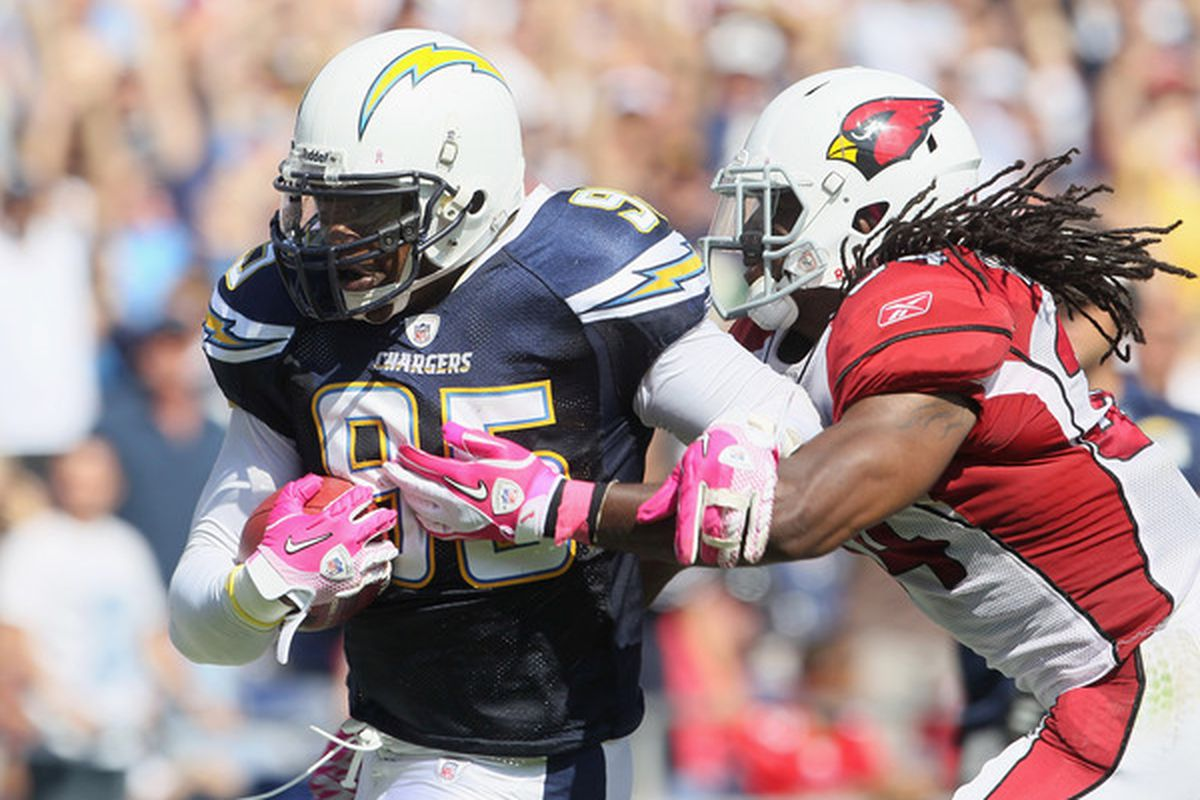 Shaun Phillips running to pay dirt as the Chargers defense attempts to announce its presence with authority. (Photo by Jeff Gross/Getty Images)