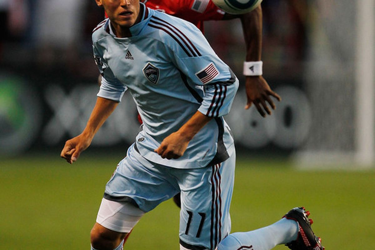 BRIDEVIEW, IL - JUNE 09: Colin Clark #11 of the Colorado Rapids and Dasan Robinson #32 of the Chicago Fire chase down the ball in an MLS match on June 5, 2010 at Toyota Park in Brideview, Illinois.  (Photo by Jonathan Daniel/Getty Images)