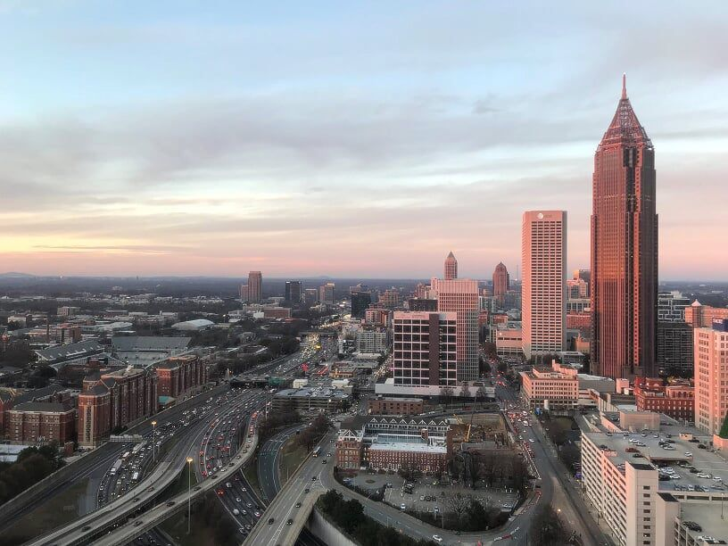 A view of Midtown Atlanta with an interstate at left.