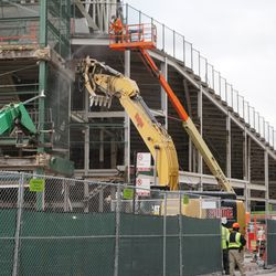 Concrete being chipped away, above the Wintrust Gate (formerly Gate D), at the corner of Addison and Sheffield