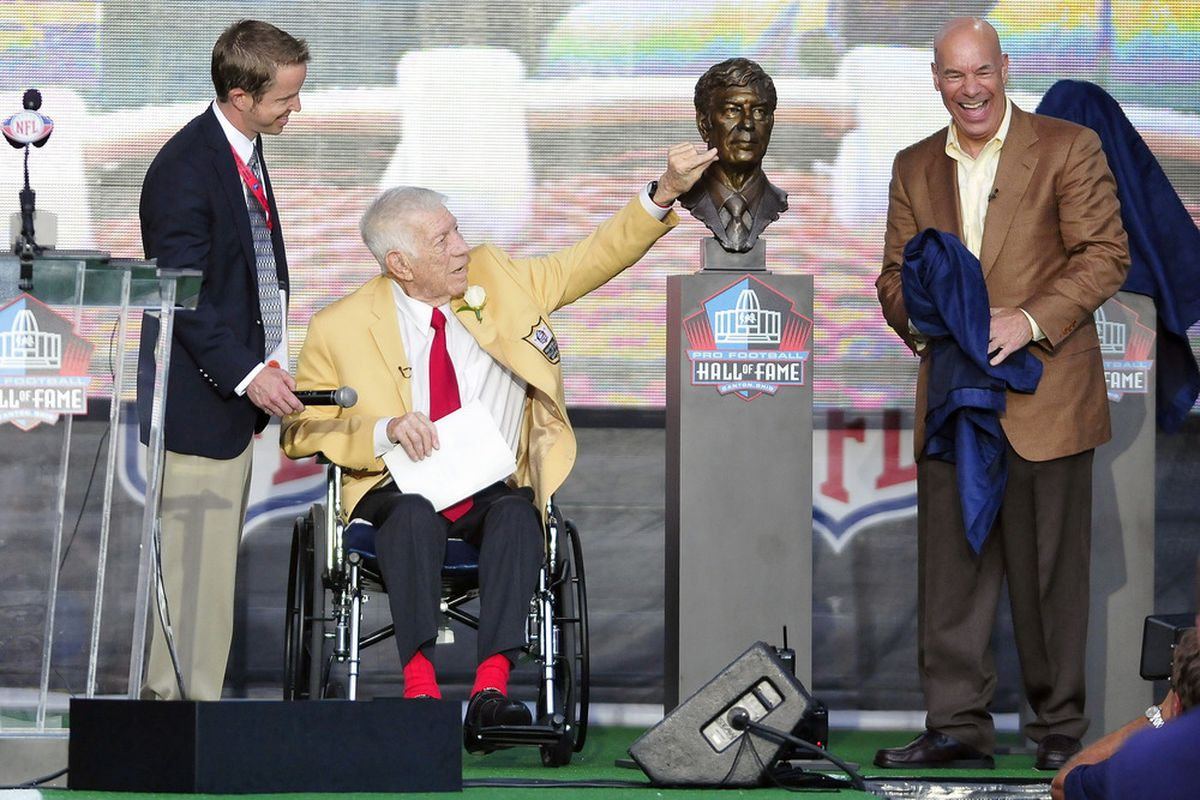 NFL Films creator Ed Sabol and Ed's son Steve Sabol unveil Sabol's bust at the Enshrinement Ceremony on August 6, 2011 in Canton, Ohio.