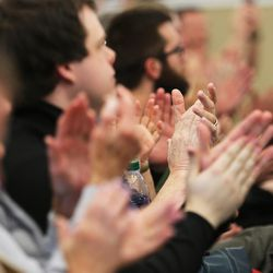 Crowd members applaud as Ohio Gov. John Kasich speaks at a Town Hall meeting in the Guest House at the University of Utah Friday, March 18, 2016.