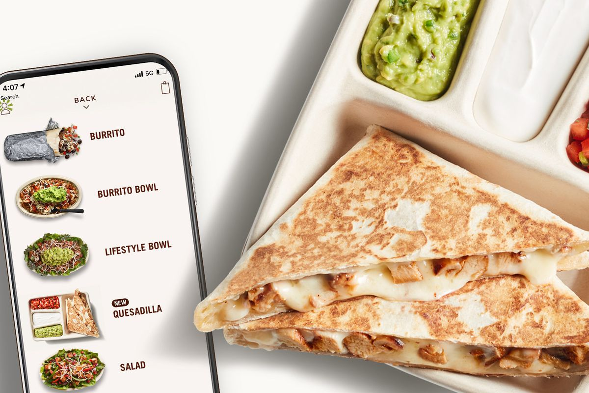 A chicken quesadilla in a takeout container, next to a smartphone featuring a takeout menu for Chipotle