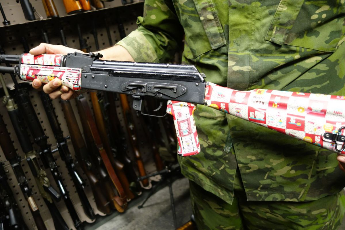 An AK-47 with a Hello Kitty print