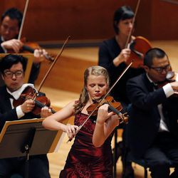 Karen Lela Ferry performs on the violin during the 55th annual Salute to Youth concert in Salt Lake City Tuesday, Sept. 30, 2014.