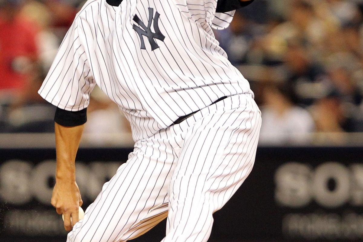 Aug 19, 2012; Bronx, NY, USA;  New York Yankees starting pitcher Hiroki Kuroda (18) pitches during the first inning against the Boston Red Sox at Yankee Stadium. Mandatory Credit: Anthony Gruppuso-US PRESSWIRE