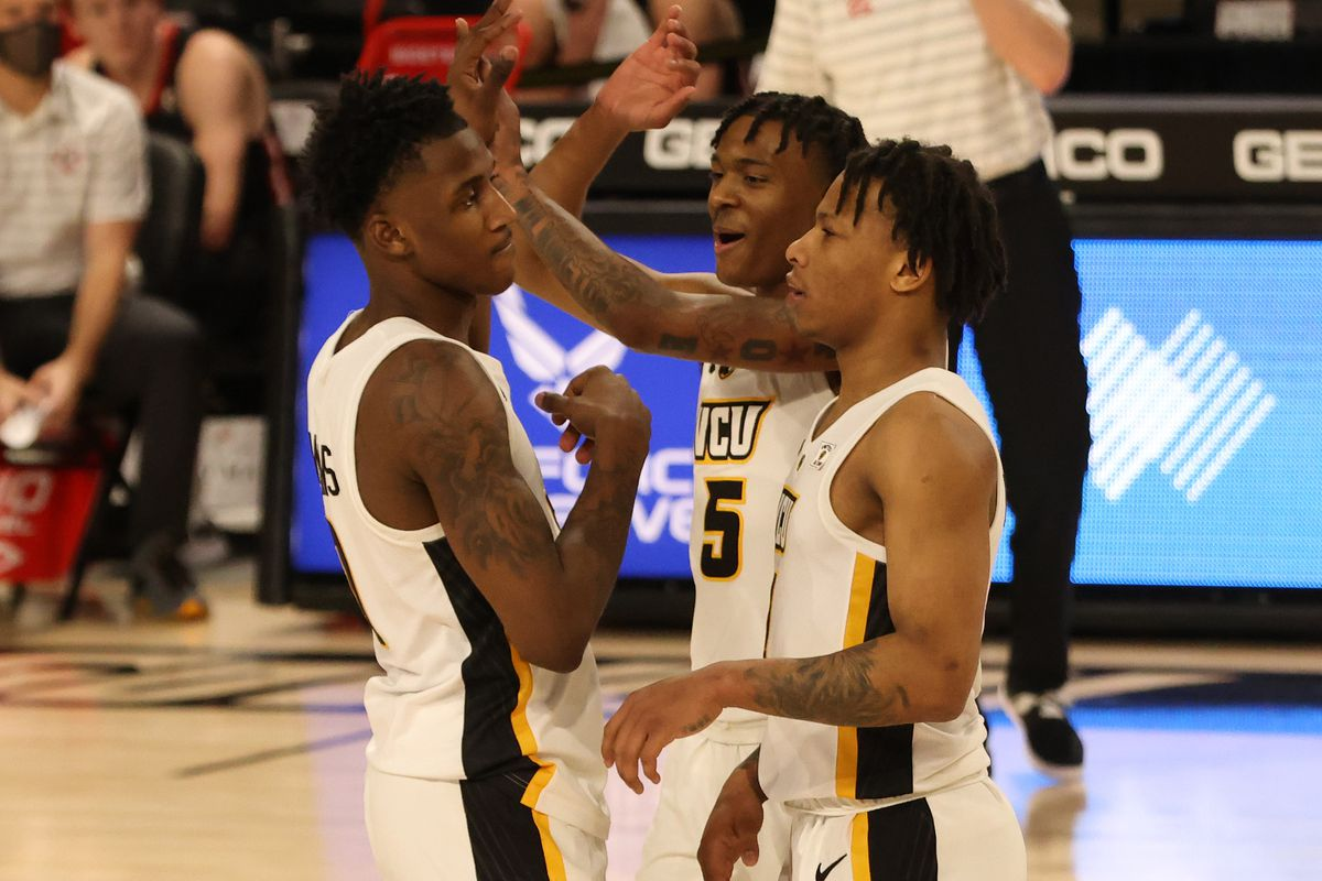 VCU Rams forward Jamir Watkins celebrates with Rams guard Nah'Shon Hyland and Rams guard Adrian Baldwin Jr. in the second half in a semifinal of the Atlantic 10 conference tournament at Stuart C. Siegel Center.