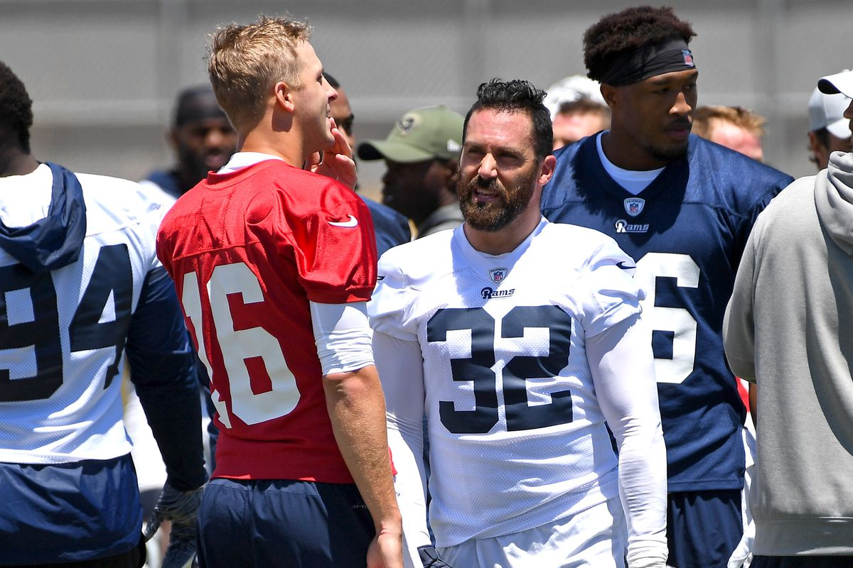 Los Angeles Rams QB Jared Goff and S Eric Weddle talk during organized team activities, May 20, 2019.