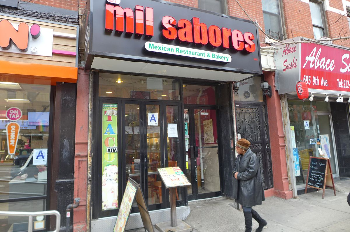 A black storefront with red letters.