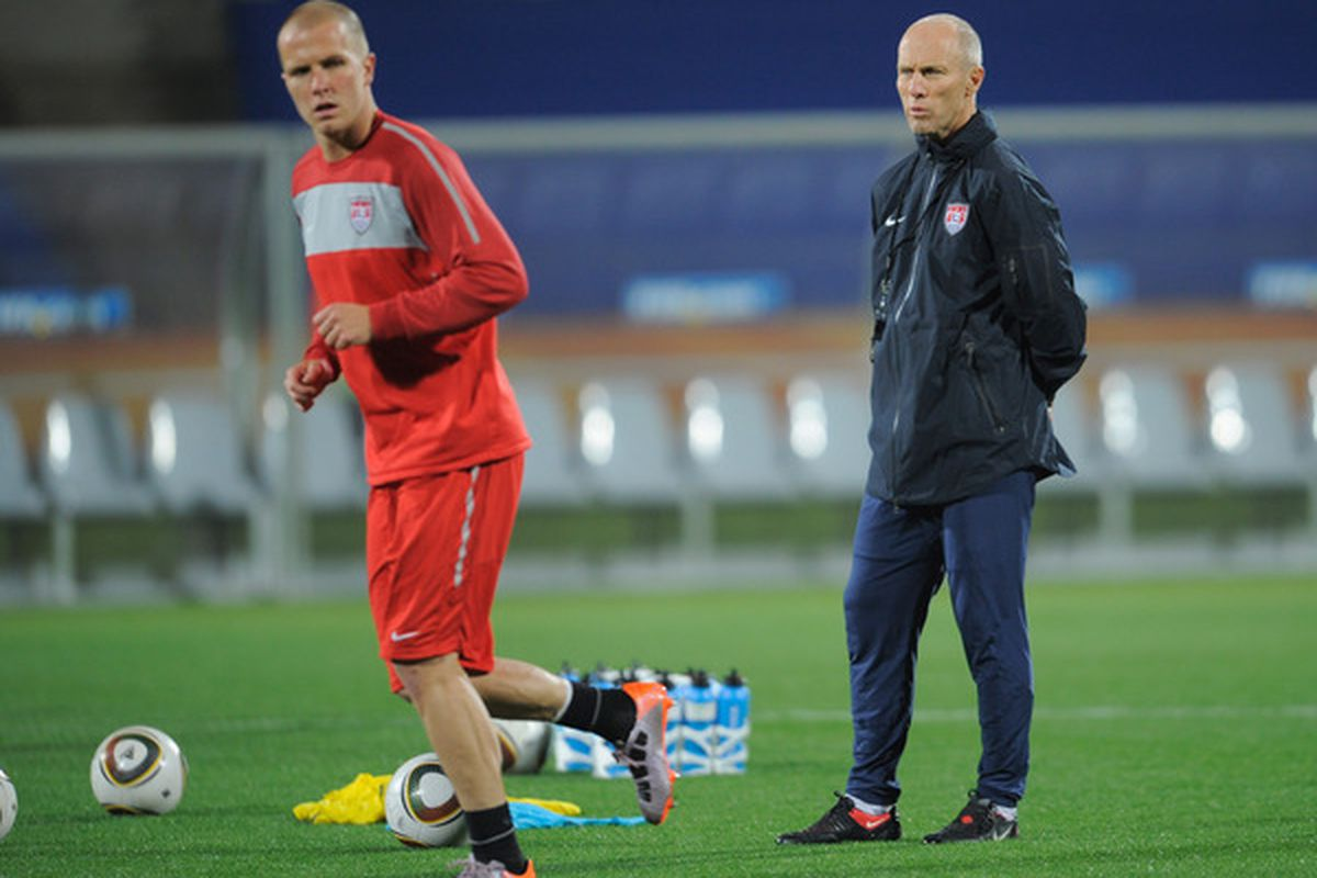 RUSTENBURG, SOUTH AFRICA - JUNE 11: USA manager Bob Bradley looks on as Michael Bradley trains during the USA training session at the Royal Bafokeng Stadium on June 11, 2010 in Rustenburg, South Africa.  (Photo by Michael Regan/Getty Images)