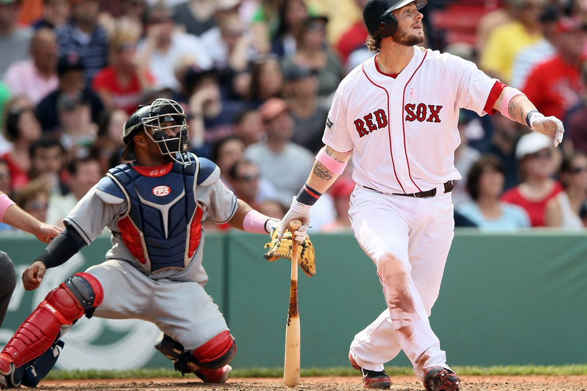 BOSTON, MA - MAY 13:  Jarrod Saltalamacchia watches his two run homer fly out of the park as Carlos Santana #41 of the Cleveland Indians catches on April 21, 2012 at Fenway Park in Boston, Massachusetts.  (Photo by Elsa/Getty Images)