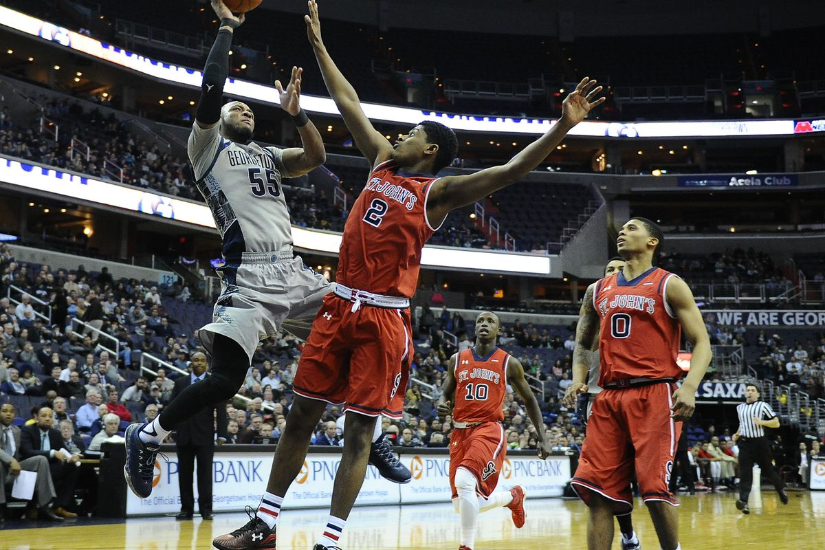 Jabril Trawick of Georgetown drives the lane against St. John's Jamal Branch during the Hoyas 79-57 victory Tuesday night at the Verizon Center.
