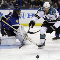 San Jose Sharks' Martin Havlat, right, of the Czech Republic, reaches for a loose puck as St. Louis Blues goalie Jaroslav Halak, of Slovakia, watches during the first period in Game 2 of an NHL Stanley Cup first-round hockey playoff series Saturday, April 14, 2012, in St. Louis.
