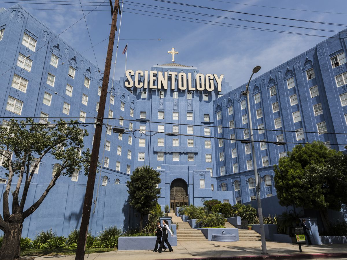 A large blue building. A sign on top of the building reads: Scientology.