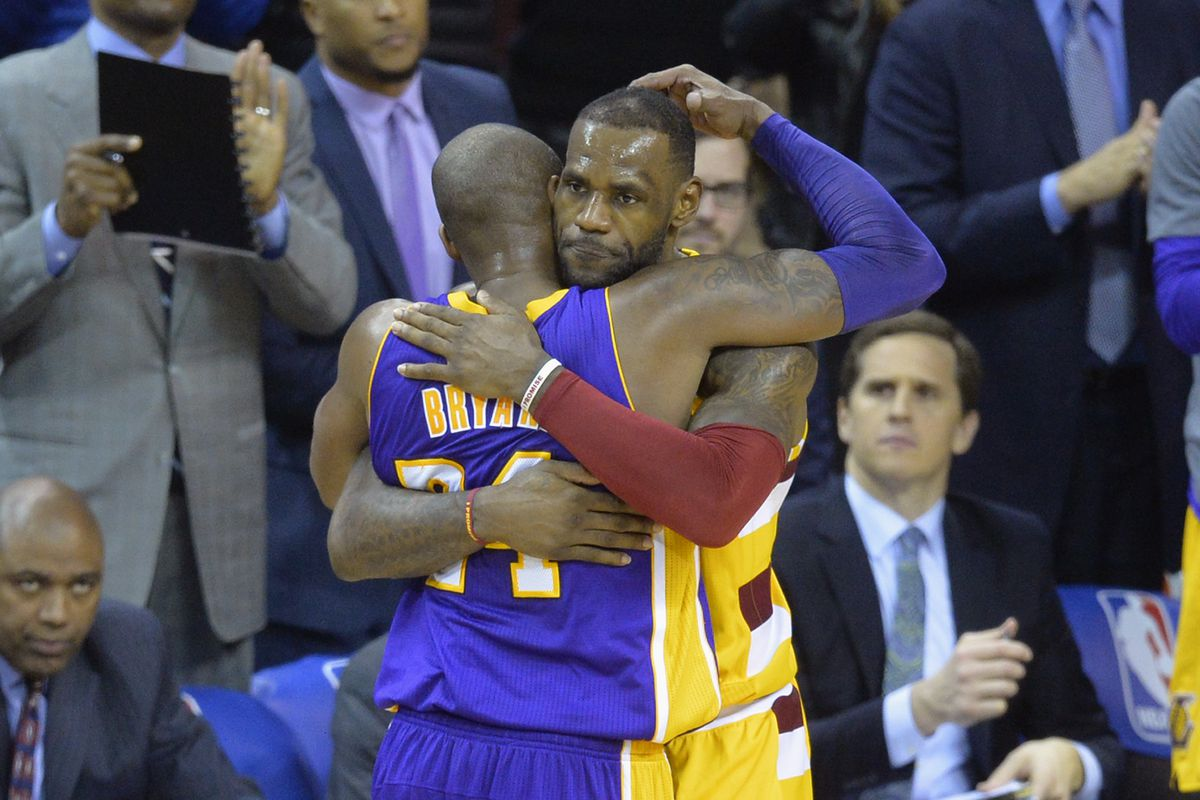Cleveland Cavaliers forward LeBron James hugs Los Angeles Lakers forward Kobe Bryant near the end of the Cavaliers' 120-111 win at Quicken Loans Arena.