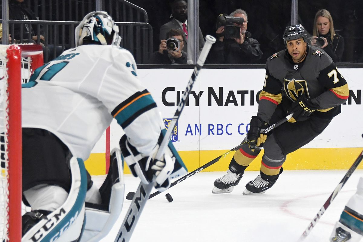 Martin Jones #31 of the San Jose Sharks tends net as Ryan Reaves #75 of the Vegas Golden Knights skates with the puck in the second period of their preseason game at T-Mobile Arena on September 29, 2019 in Las Vegas, Nevada.
