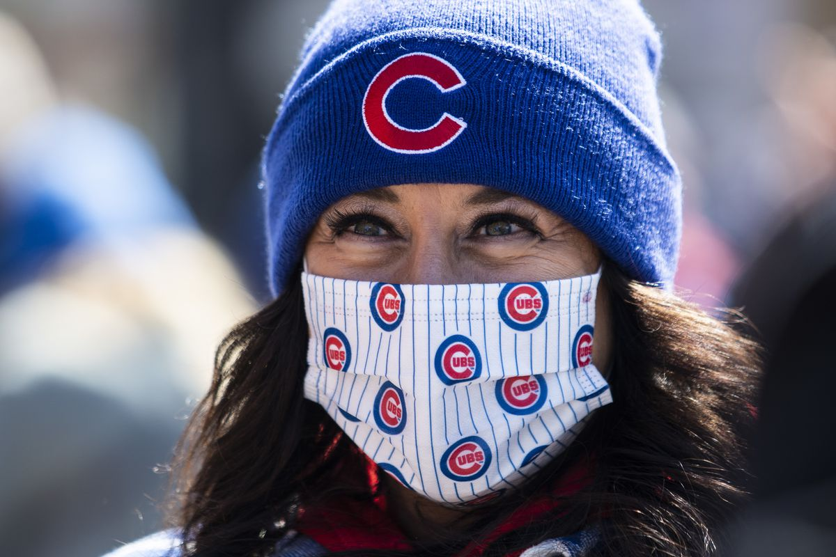 Carla Piunti, 50, of Chicago Heights, smiles as she prepares to enter Wrigley Field before the Chicago Cubs Opening Day game against the Pittsburgh Pirates.