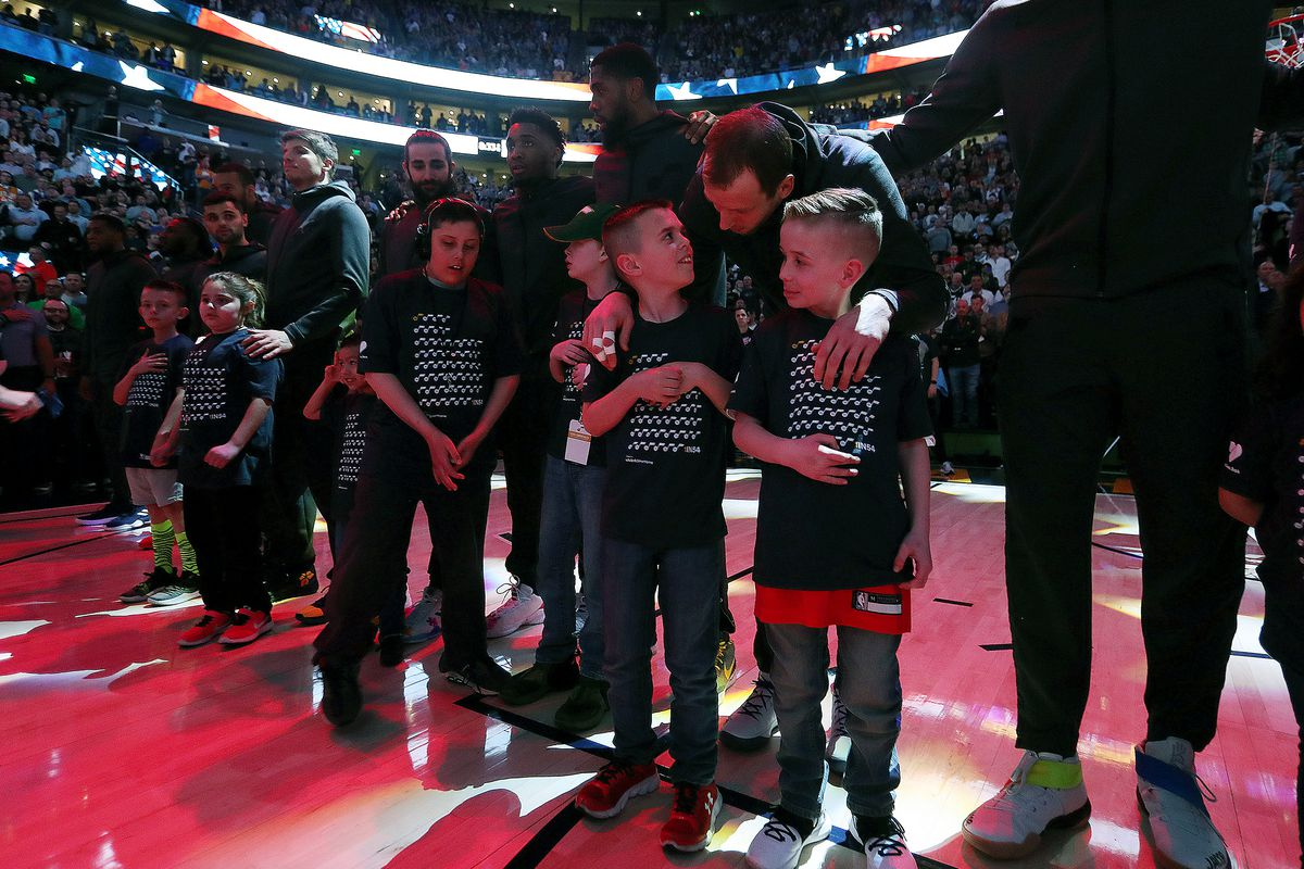 Utah Jazz forward Joe Ingles (2) talks with a couple young boys prior to the game as Utah Jazz and the Las Angeles Lakers play at Vivint Smart Home Arena in Salt lake City on Wednesday, March 27, 2019. As the the Utah Jazz recognize Autism.