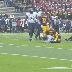Robi Stuart and Devonni Reed share a tackle-for-loss on Bryant Koback.