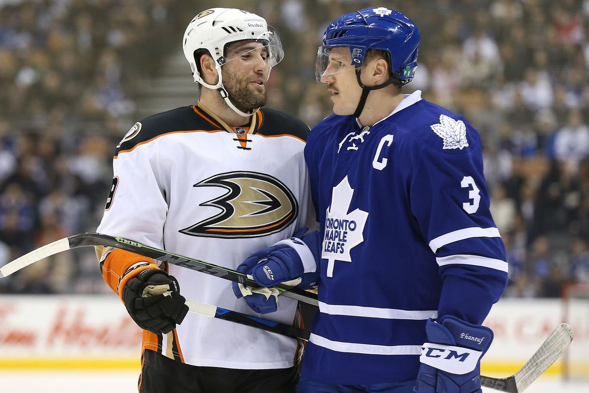 Patrick Maroon shares a word with Dion Phaneuf earlier this season.