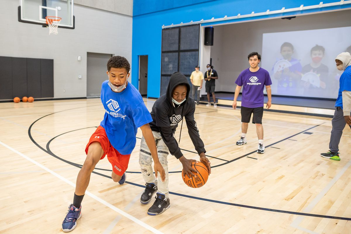 Travis Pfeil and Eritier Ishimael play basketball in the gym at the Spence Eccles Boys & Girls Club in Salt Lake City.