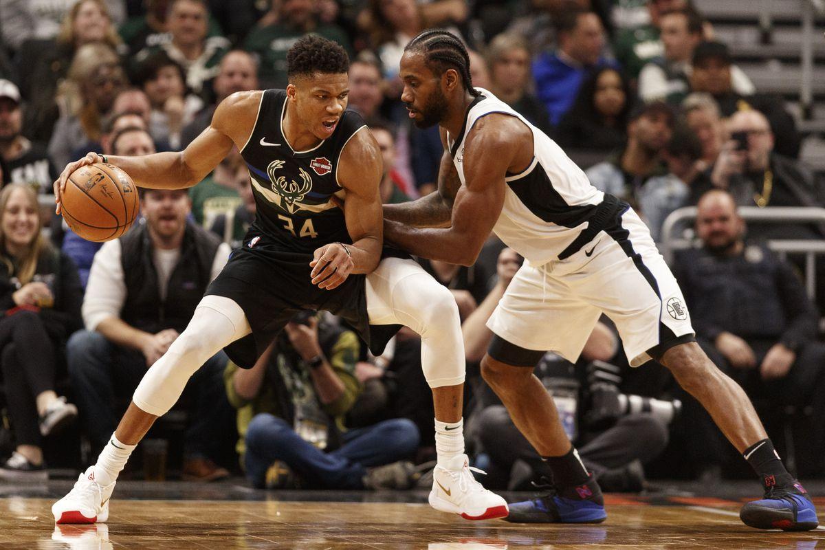 Milwaukee Bucks forward Giannis Antetokounmpo works for a shot against Los Angeles Clippers forward Kawhi Leonard during the third quarter at Fiserv Forum.