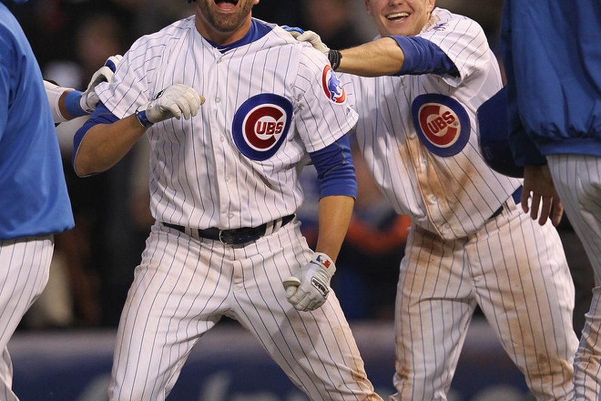 David DeJesus and Tony Campana of the Chicago Cubs celebrate a win over the Los Angeles Dodgers at Wrigley Field in Chicago, Illinois. The Cubs defeated the Dodgers 4-3 in 11 innings. (Photo by Jonathan Daniel/Getty Images)