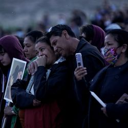 Sophia Hernandez's parents, Maria and Jimmy Hernandez, embrace as friends share memories during a vigil for Sophia and her friend Priscilla Bienkowski on the west side of Utah Lake on Saturday, May 9, 2020. Teenagers Sophia Hernandez and Priscilla Bienkowski have been missing since going to the lake on Wednesday.